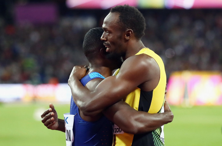 Usain Bolt hugs Justin Gatlin after the US sprinter has beaten him in the 100 metres, the final individual race of his career at the IAAF World Championships in London ©Getty Images