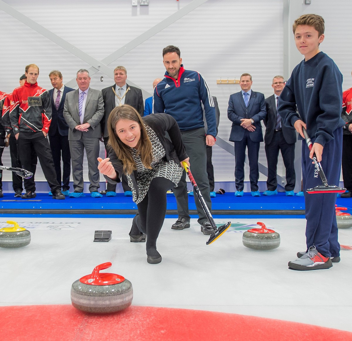 Aileen Campbell, Minister for Public Health and Sport, delivers the opening stone at the newly opened National Curling Academy in Stirling, Scotland ©Alan Peebles