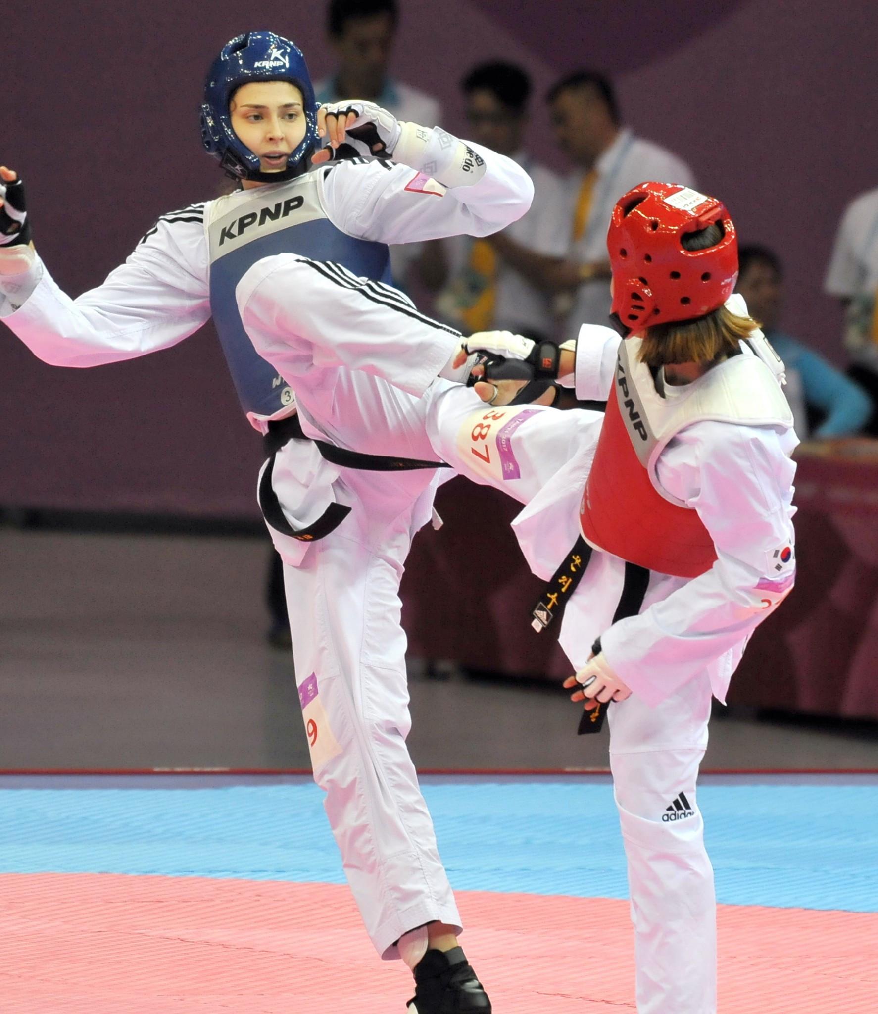 Turkey's Irem Yaman, left, won the women's under-62kg title ©Taipei 2017