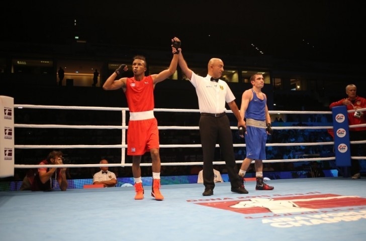 Cuba's Lazaro Alvarez, left, claimed his third world crown with a technical knockout win over Azerbaijan's Albert Selimov at the 2015 World Championships in Doha ©Hill+Knowlton Strategies