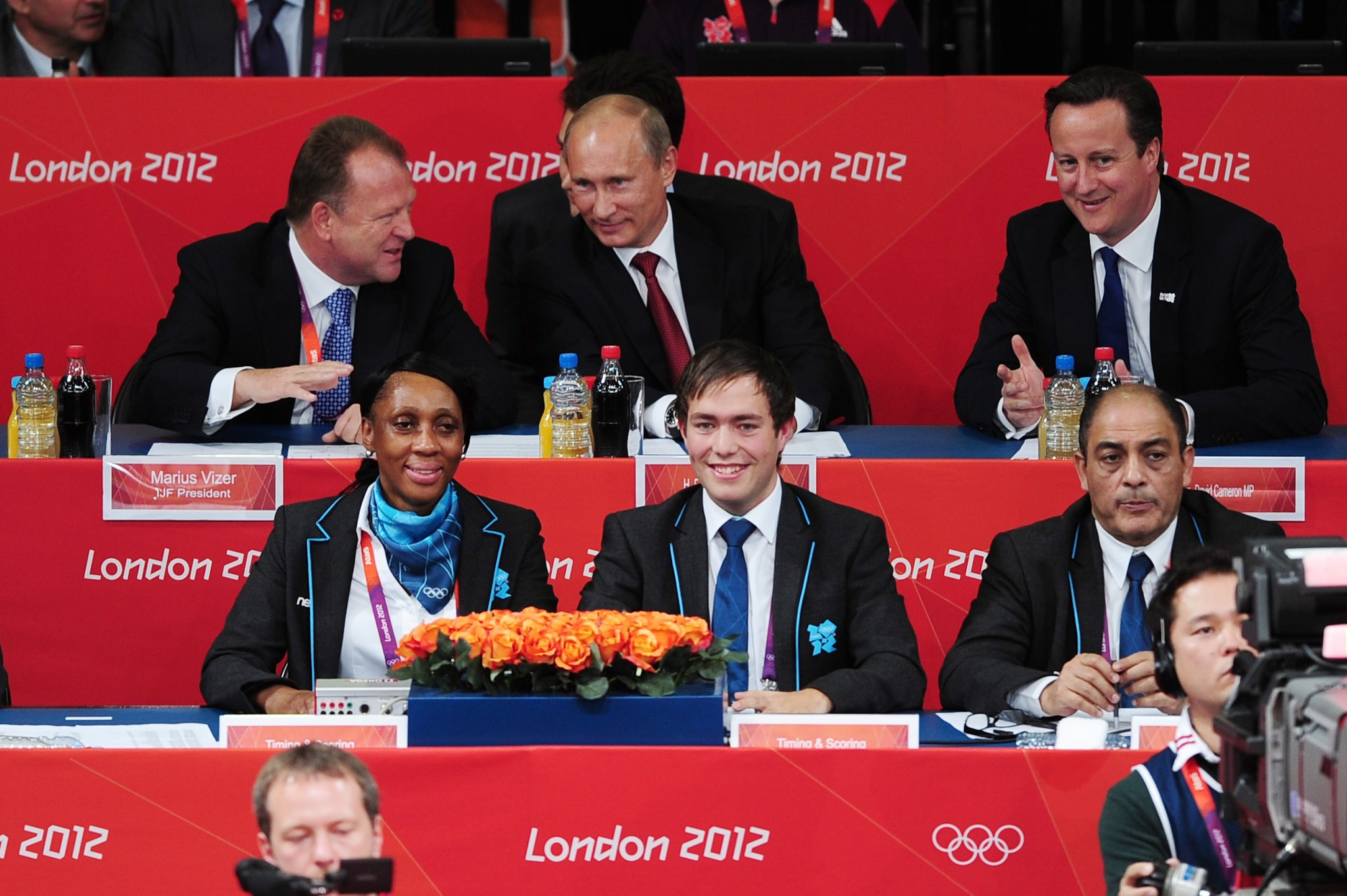 Vladimir Putin, centre, attended the judo at London 2012 along with then British Prime Minister David Cameron, right, and Marius Vizer, left, President of the IJF ©Getty Images