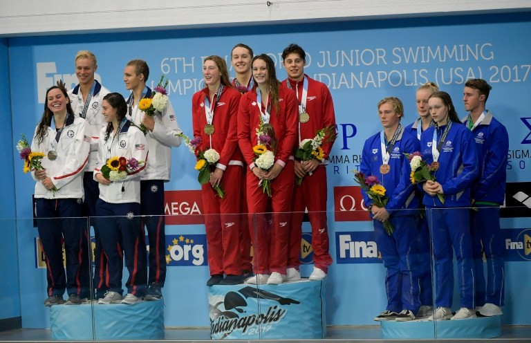 Canada set a world junior record to win the mixed relay ©FINA
