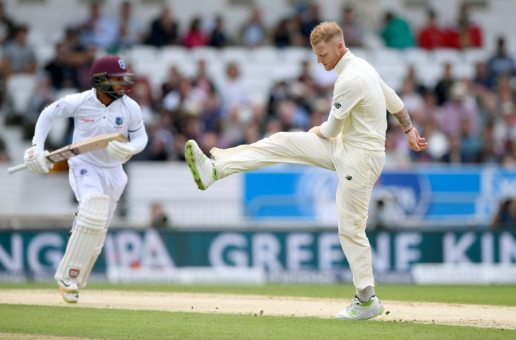 England's Ben Stokes reacts on the second day of play in the Headingley test as West Indies' Shai Hope makes runs off one of his deliveries ©Getty Images