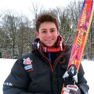 British skier claims suffering from just sore head as returns home after coma scare