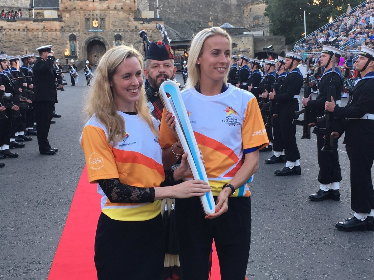 Two-time Commonwealth Games swimming gold medallist Hannah Miley, and Lynsey Sharp, the 800 metres silver medallist at Glasgow 2014, carried the Queen's Baton down the Castle Esplanade during its last day in Scotland ©Team Scotland