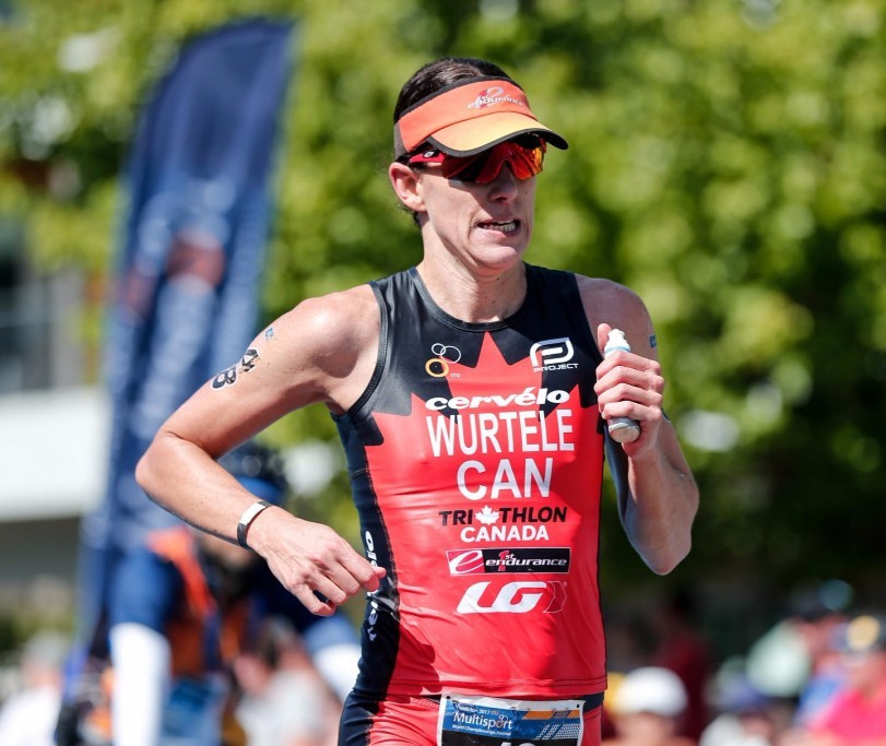 Lionel Saunders defied a puncture to win the ITU Long Distance world title ©ITU