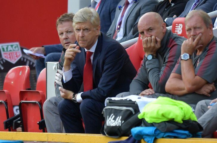 Message deleted - Arsenal's manager Arsene Wenger, second left, looks on as his side turn a 2-0 half-time deficit into a a 4-0 full-time deficit against Liverpool at Anfield on Sunday ©Getty Images