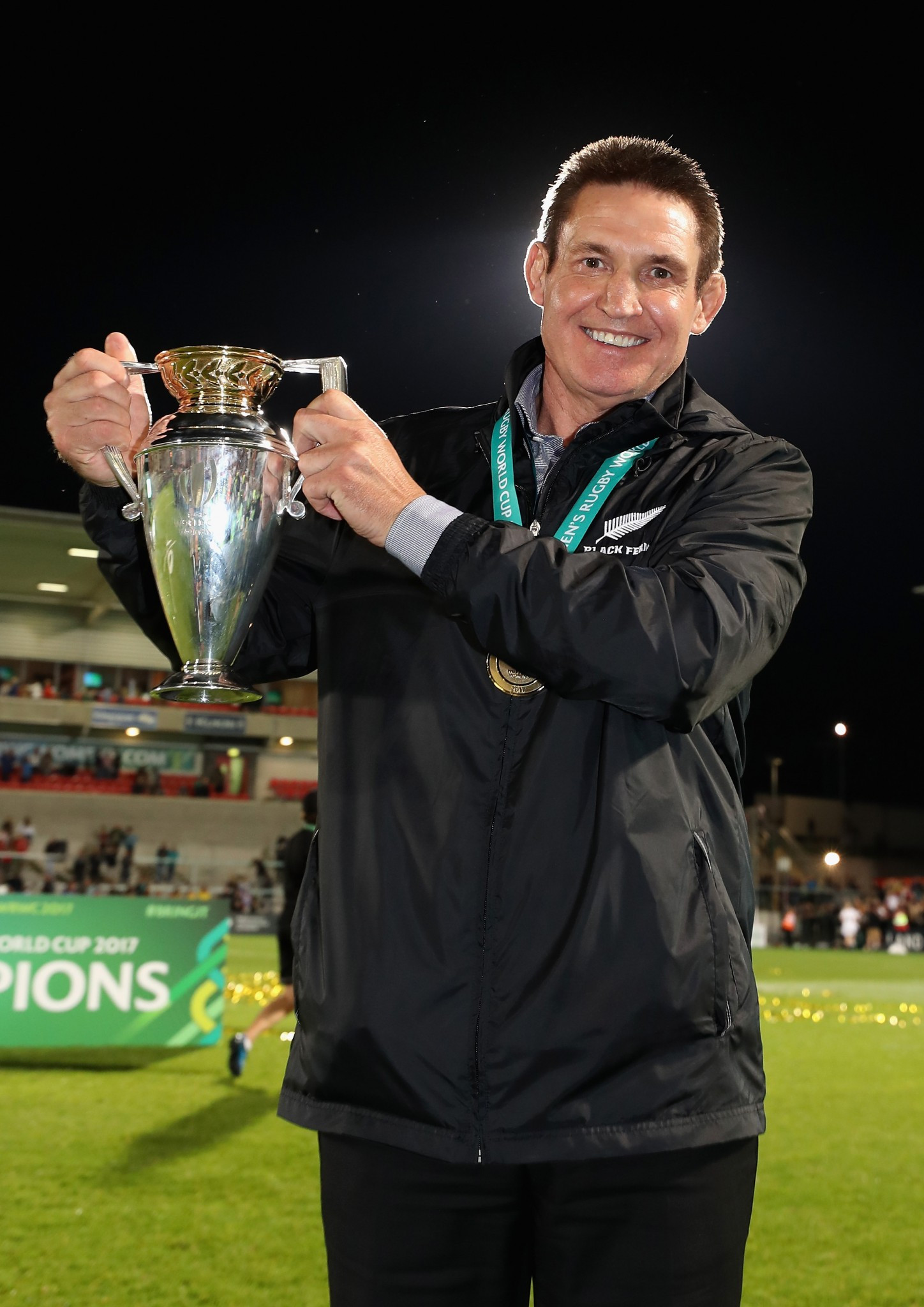 Mixed message? Glenn Moore, head coach of New Zealand's Black Ferns, displays the Women's Rugby World Cup they regained against England in Belfast after recovering from 17-10 down at half-time ©Getty Images