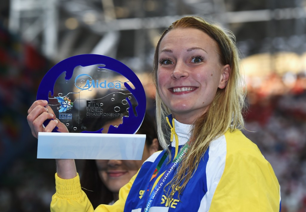 Sarah Sjostrom celebrated winning gold and breaking her own women's 100m butterfly world record ©Getty Images