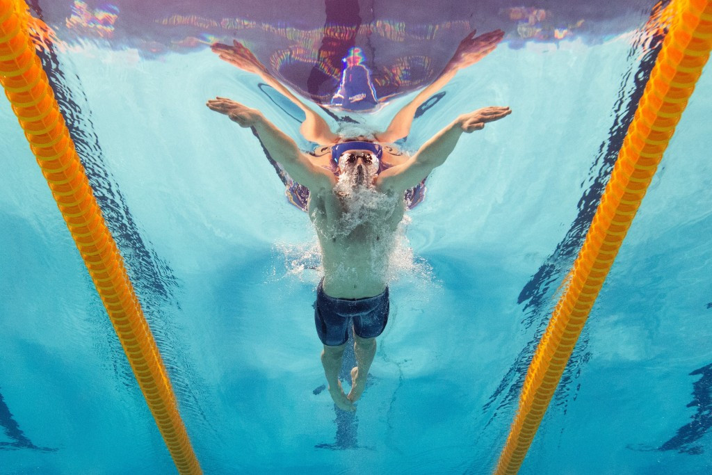 Britain's Adam Peaty came from behind to win the men's 100m breaststroke title