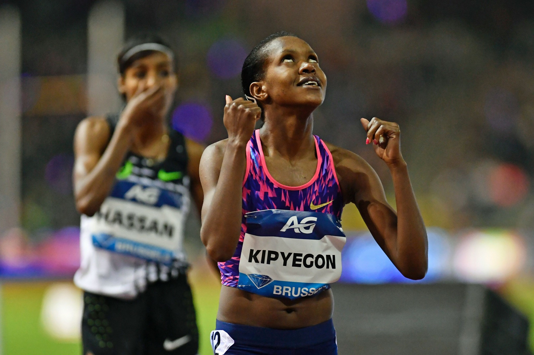 Kenya's world 1,500m champion Faith Kipyegon celebrates a hard-fought victory over Sifan Hassan in the Brussels IAAF Diamond League final ©Getty Images