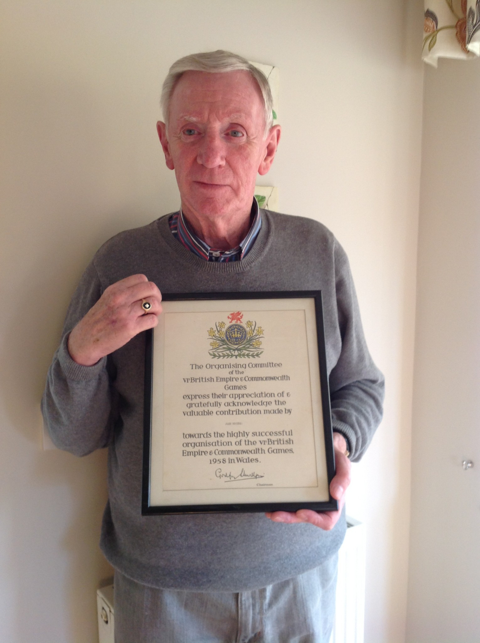 John Rogers displays a certificate recalling his involvement in the 1958 Baton Relay ©Graham Greasley