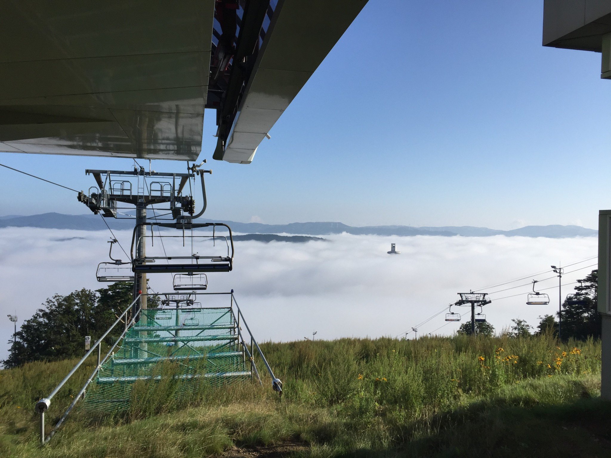 A view into the mist-strewn valley where the Alpensia hub is housed and where he top of the ski jumping tower for Pyeongchang 2018 is just visible above the clouds ©Lorna Campbell