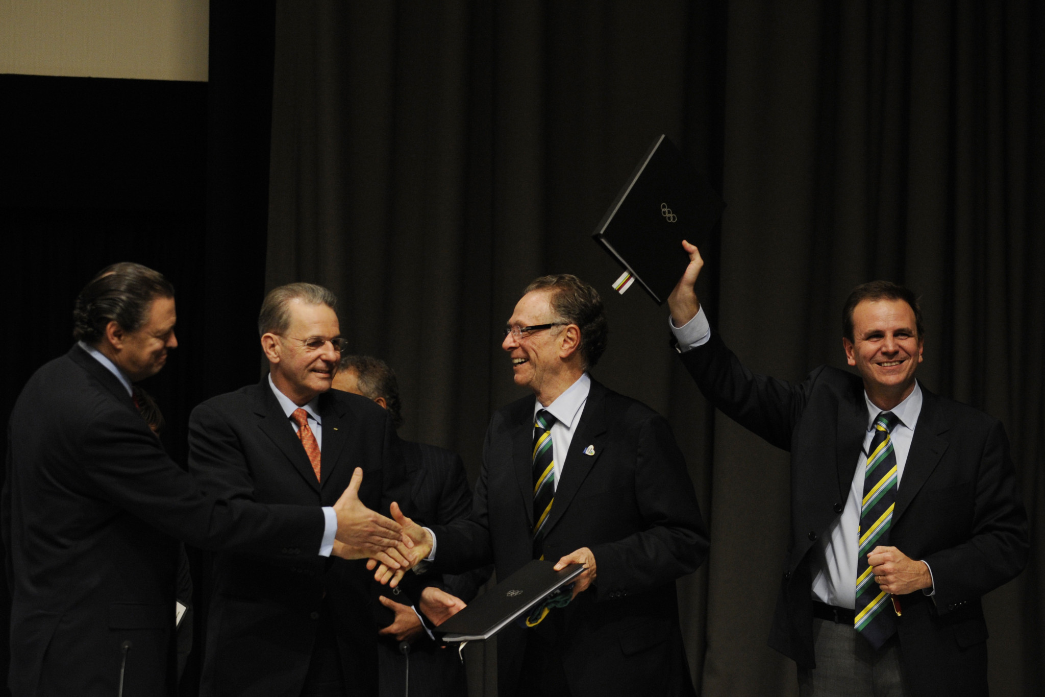 Carlos Nuzman, centre, pictured celebrating with former IOC President Jacques Rogge after Rio de Janeiro was awarded the Olympic and Paralympics at Copenhagen in 2009 ©Getty Images