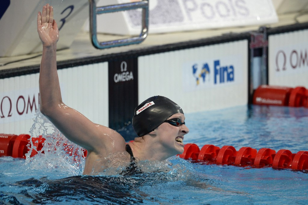 American youngster Katie Ledecky powered to victory in the women's 1,500m freestyle in a world record time