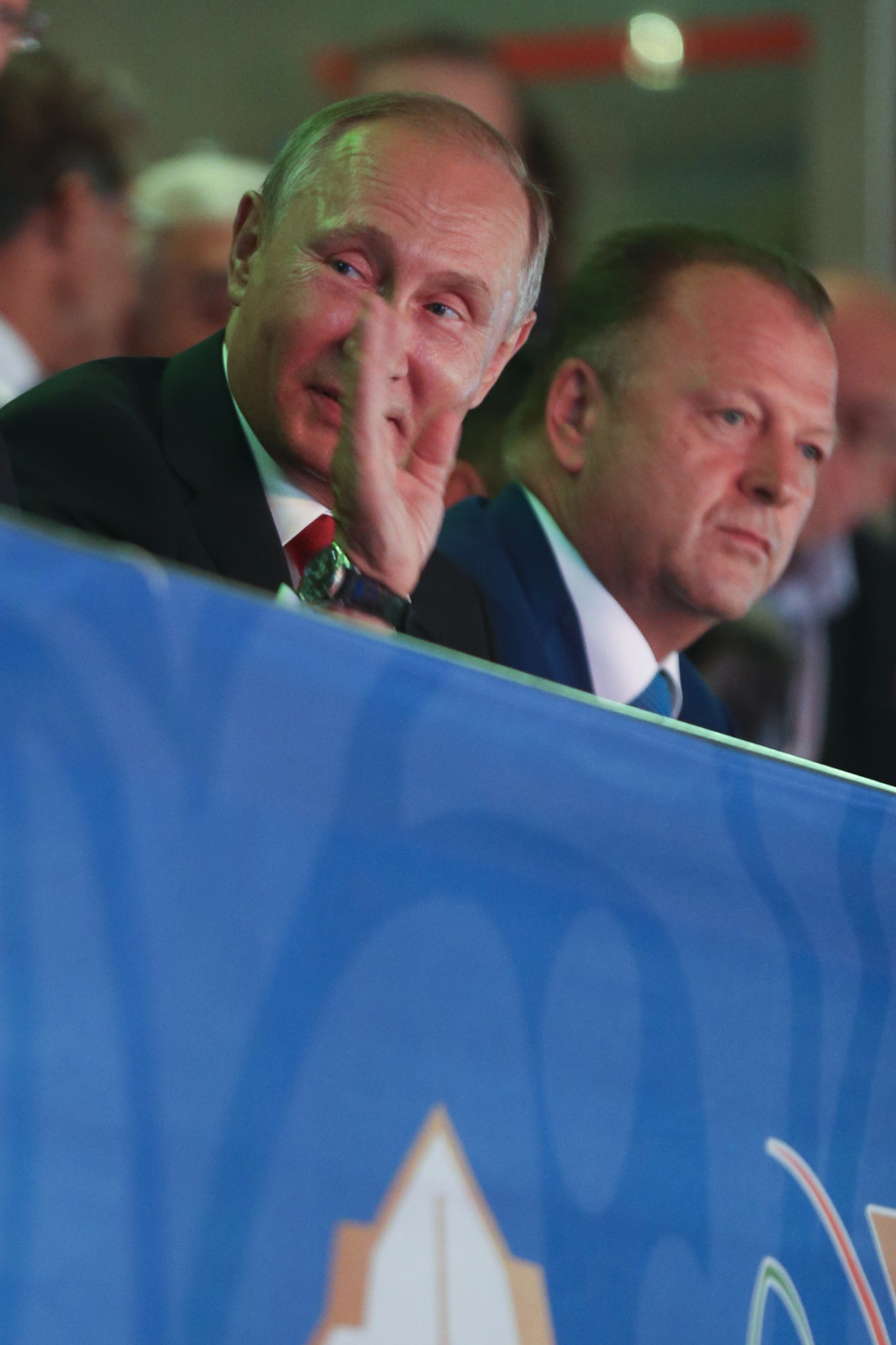 Russian President Vladimir Putin, left, waves next to Marius Vizer, head of the International Judo Federation, right, during the World Championships in Budapest ©Getty Images