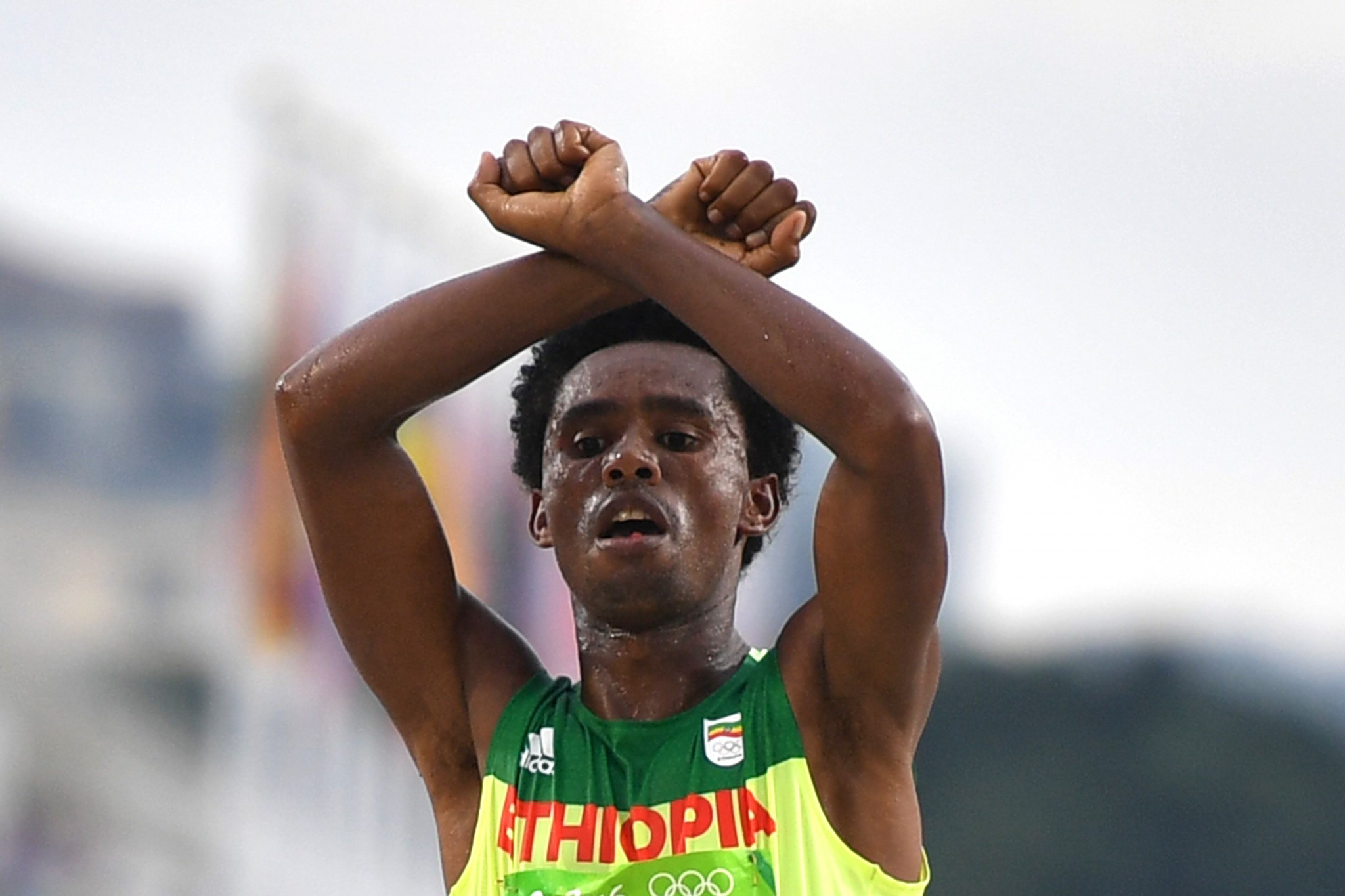 Feyisa Lilesa, pictured showing solidarity with his Oromo people in taking Olympic marathon silver last summer, will give Mo Farah a run for his money at tomorrow's Great North Run ©Getty Images