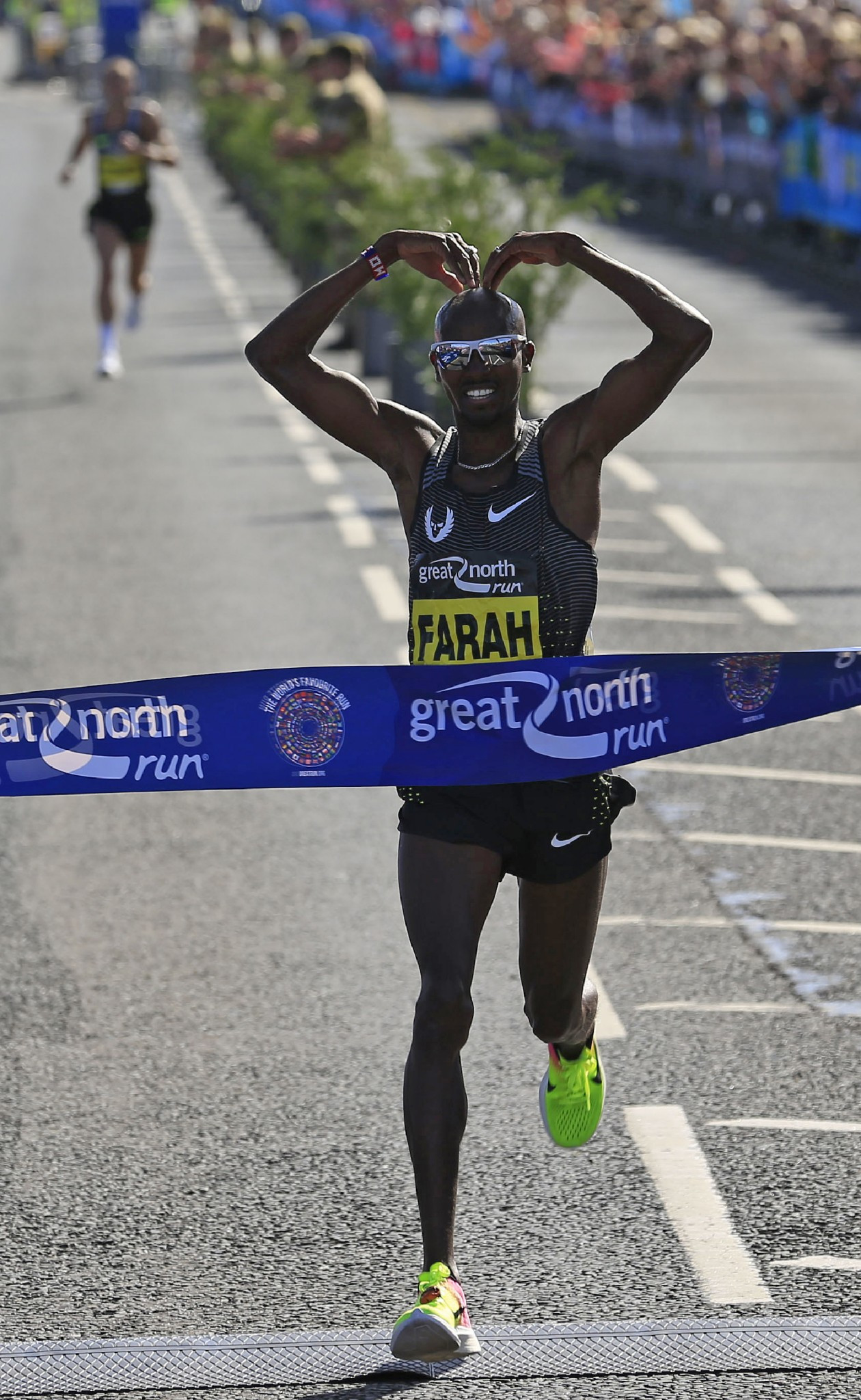 Britain's Sir Mo Farah winning a third consecutive Great North Run title last year - but Ethiopia's Olympic marathon silver medallist Feyisa Lilesa will test his ambitions of winning a fourth title tomorrow ©Getty Images
