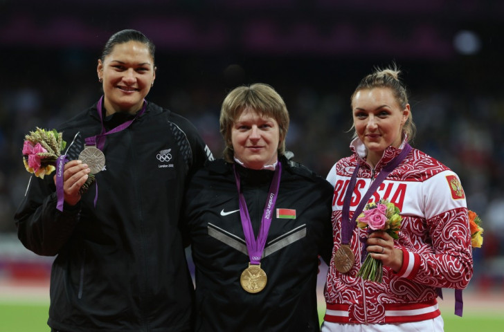 Valerie Adams of New Zealand (left) with shot put silver at the London 2012 Games. Before the year was out she would have he gold - following the positive test returned by Nadzheya Ostapchuk of Belarus - but not the satisfaction of victory in the Olympic Stadium ©Getty Images