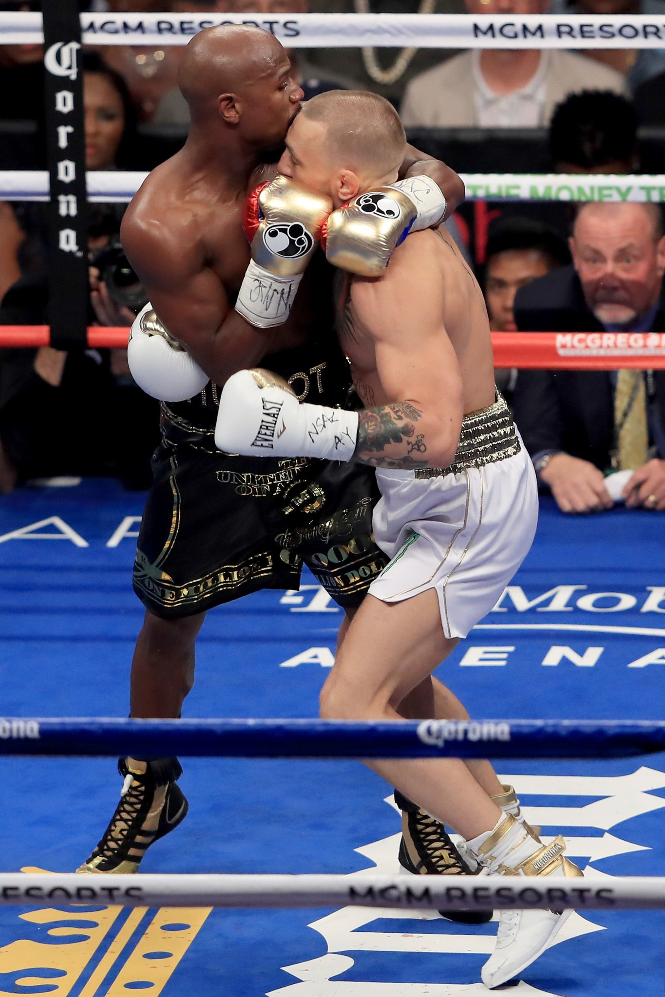 Floyd Mayweather Jr throws a punch at Conor McGregor during their boxing match ©Getty Images