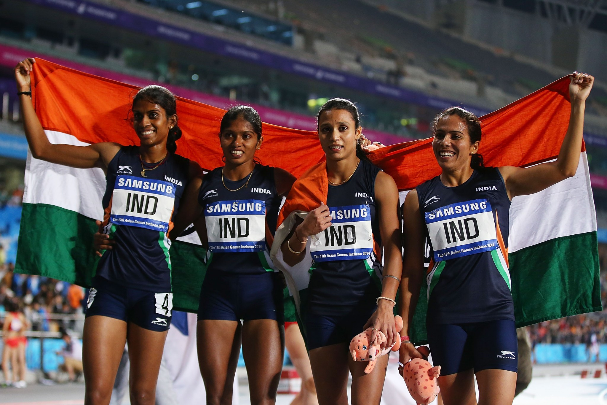 Priyanka Pawar, left, was a part of India's gold medal winning 4x400m relay team at Incheon 2014 ©Getty Images