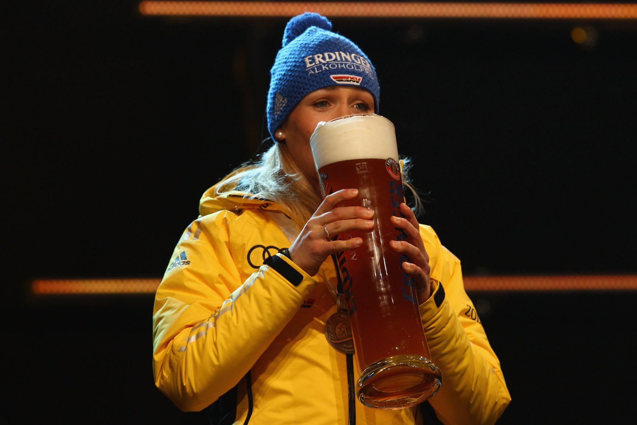 Magdalena Neuner of Germany with an Erdinger after a World Championship win in 2012 ©Getty Images