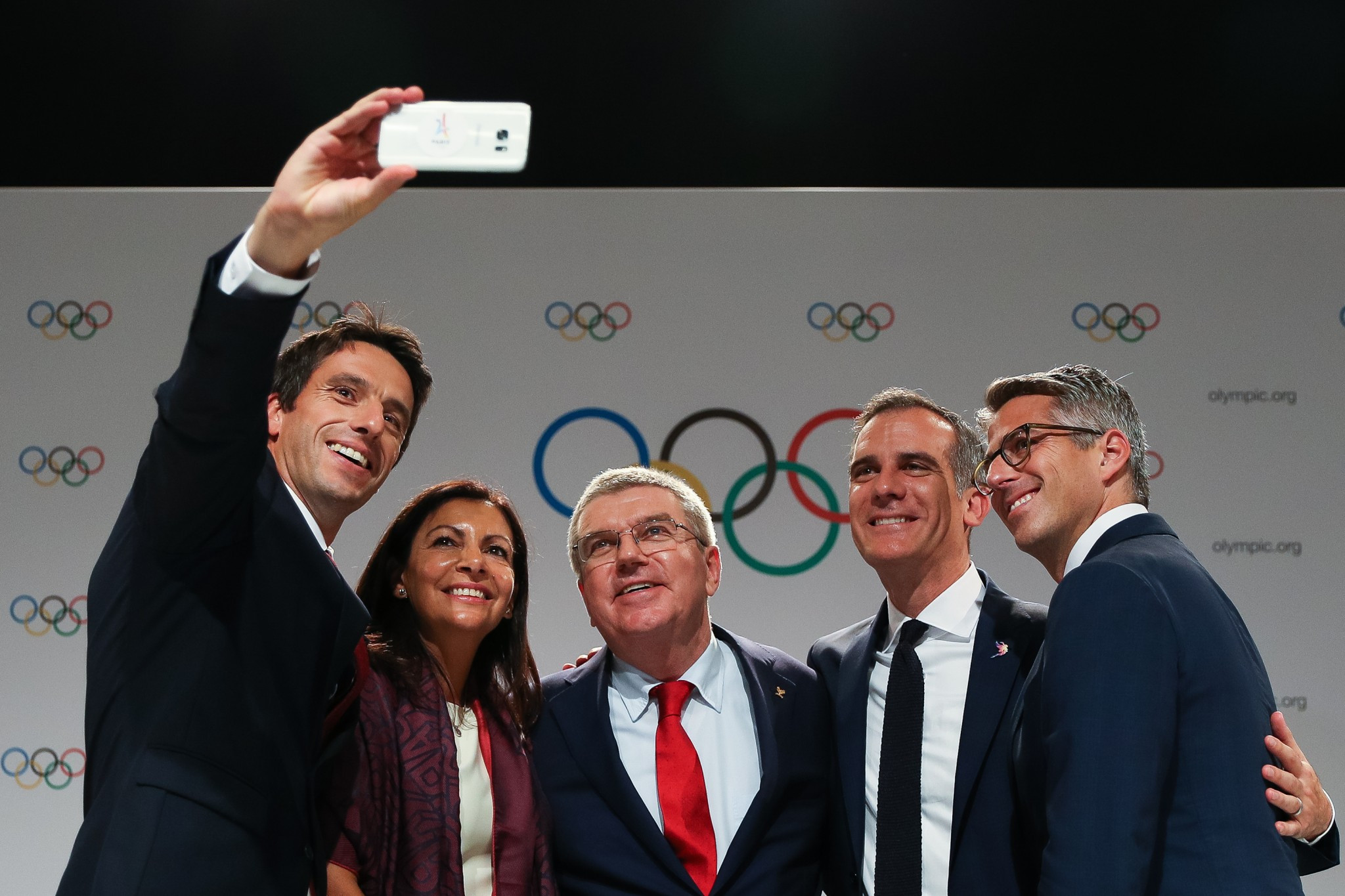 IOC President Thomas Bach hailed the agreement as a win-win-win ©Getty Images
