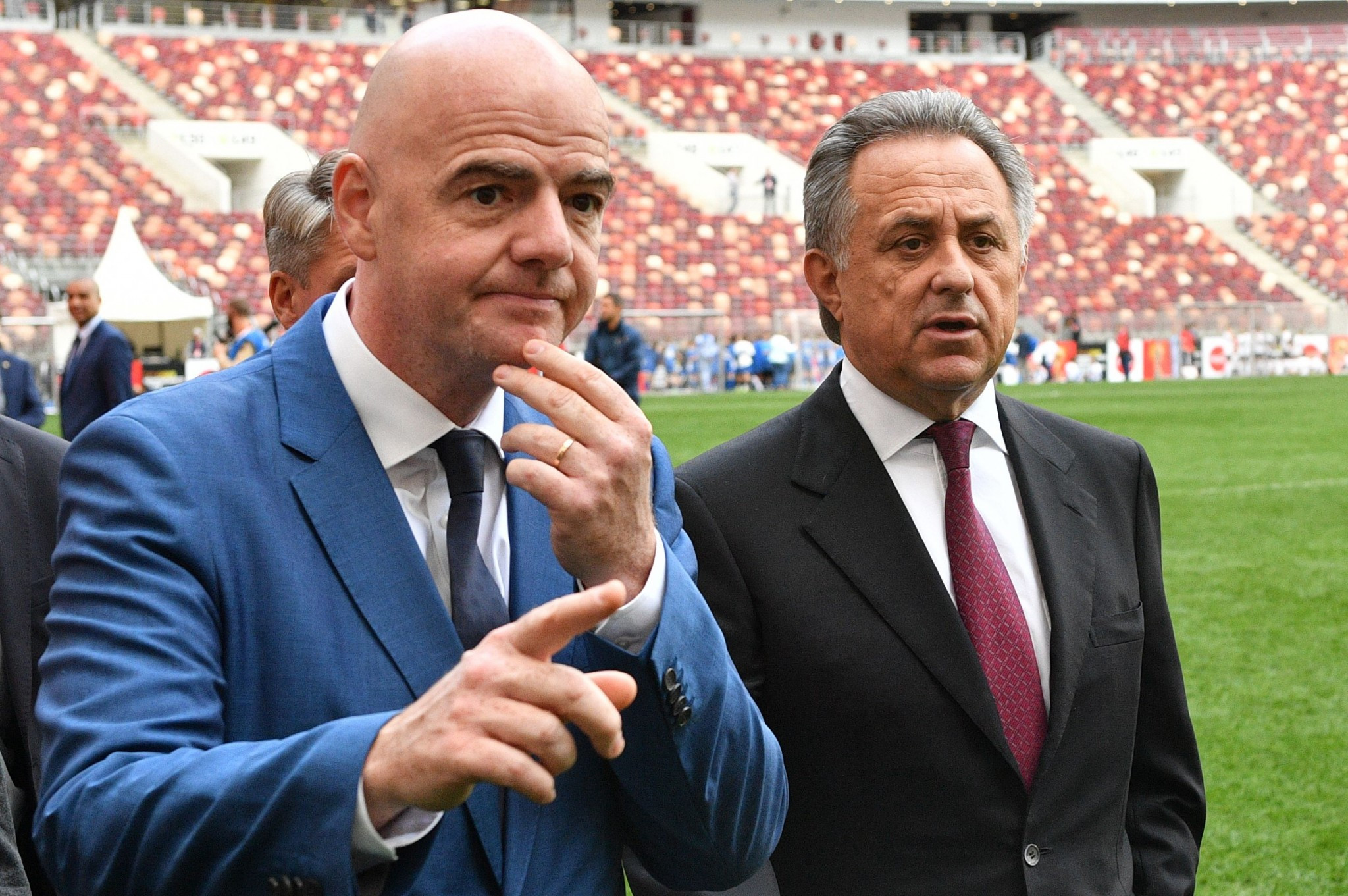 It has been alleged FIFA President Gianni Infantino, left, attempted to influence the decision to block Vitaly Mutko, right, from the organisation's Council ©Getty Images