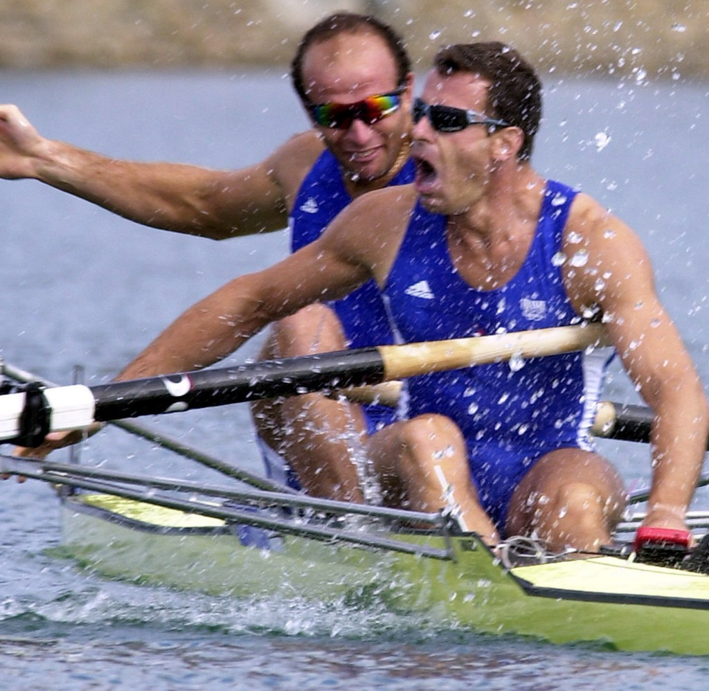 Jean-Christophe Rolland (front) celebrating Olympic gold at Sydney 2000 with Michel Andrieux ©Getty Image