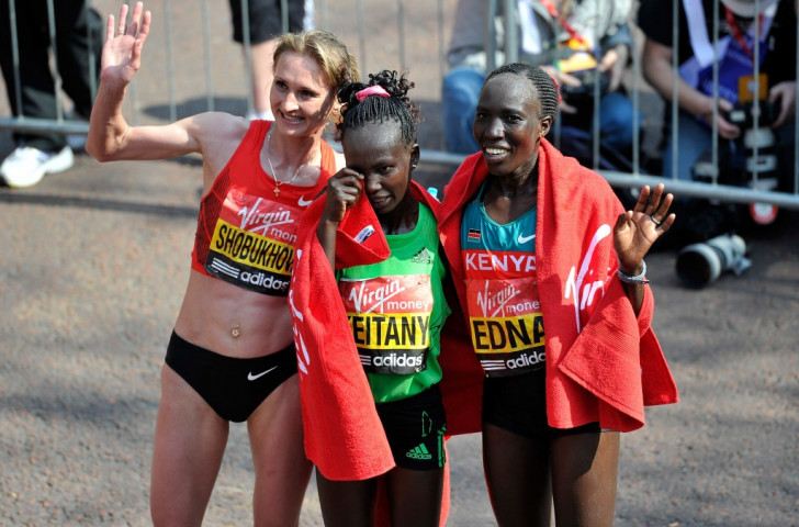 Liliya Shobukova, pctured (left) after winning the 2011 London Marathon title, will be stripped of the title and will face court action for the prize money after her doping positive. Mary Keitany (centre0 is now official winner, and fellow Kenya Edna Kiplagat (right) the silver medallist ©Getty Images