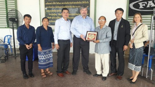 Representatives of the Laos Olympic Committee and Sports Government thanking the IFF secretary general John Liljelund, centre, ©IFF