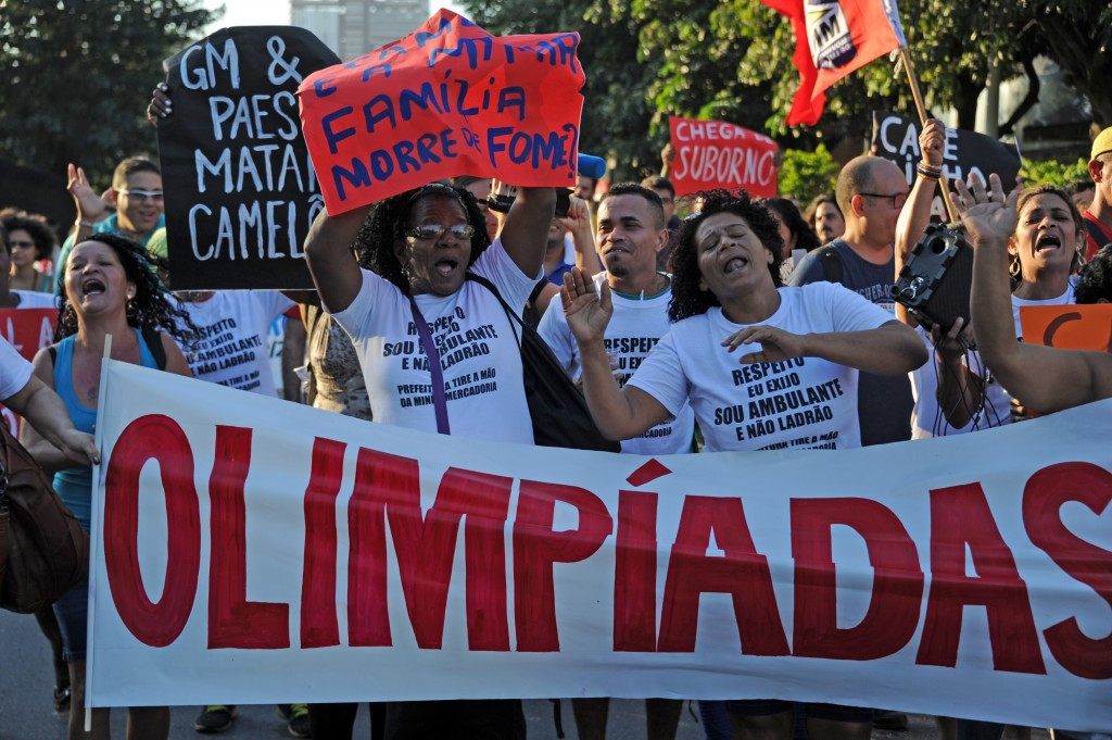 Protestors yesterday outside City Hall in Rio criticising projects assoiciated with the Games ©AFP/Getty Images