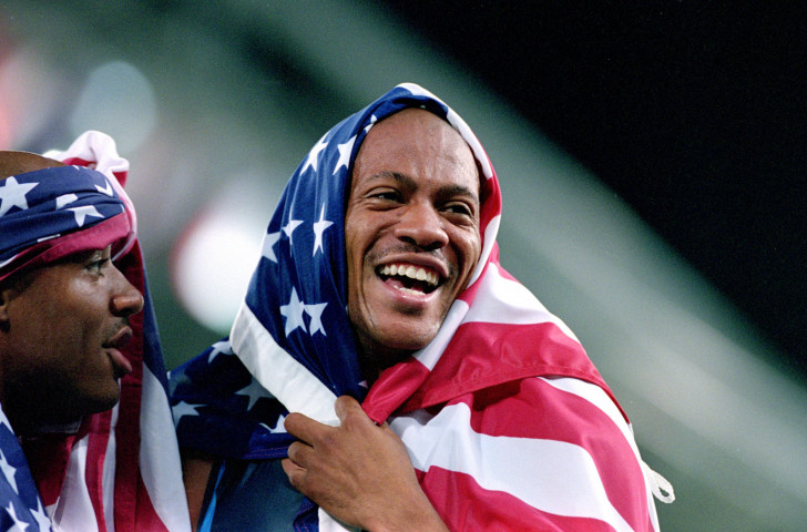 Maurice Greene celebrates winning the 4x100m gold at the 2000 Sydney Olympics. But now he has a logical problem with his greatest of all time tattoo ©Getty Images