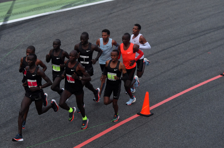Eliud Kipchoge, in orange, with his two team-mates, making an unsuccessful attempt to break two hours for the marathon at the Monza F1 track earlier this year. He's great too. But the greatest of all time? ©Getty Images