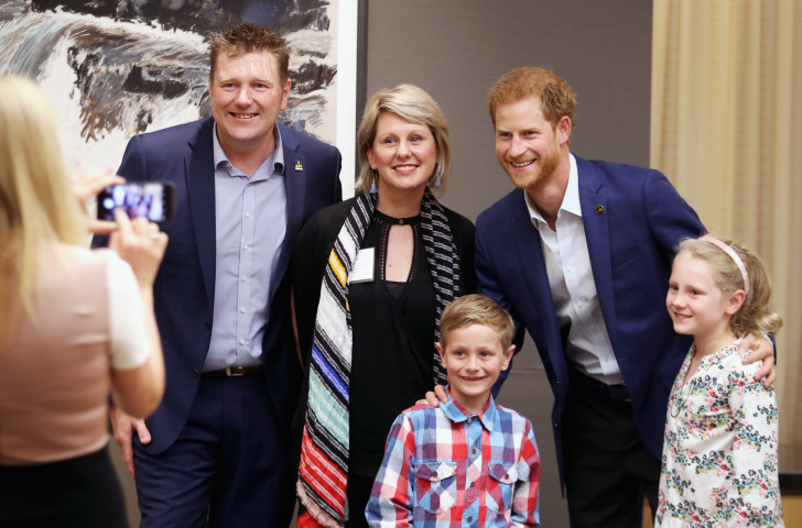 Prince Harry  with Australian veteran and athlete Mark Reidy, his wife Karen May, and their children at the True Love Patriot Symposium in Toronto ©Getty Images