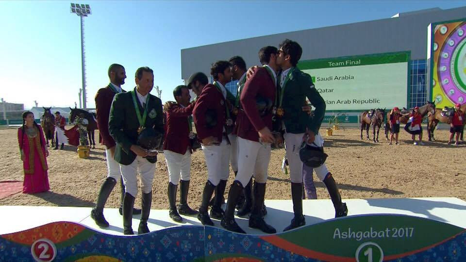 Jumpers from Saudi Arabia and Qatar embrace on top of the medals podium ©OCA