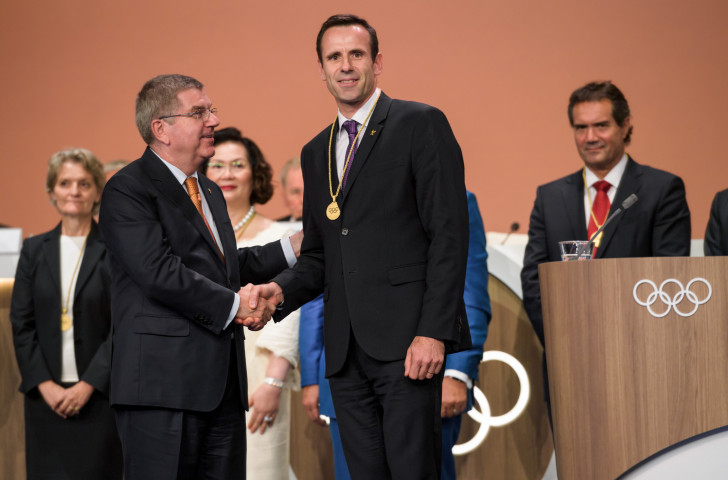 FISA President Jean-Christophe Rolland, pictured receiving IOC membership from Thomas Bach at this month's Congress in Lima, has fears for lightweight rowing's Olympic future ©Getty Images