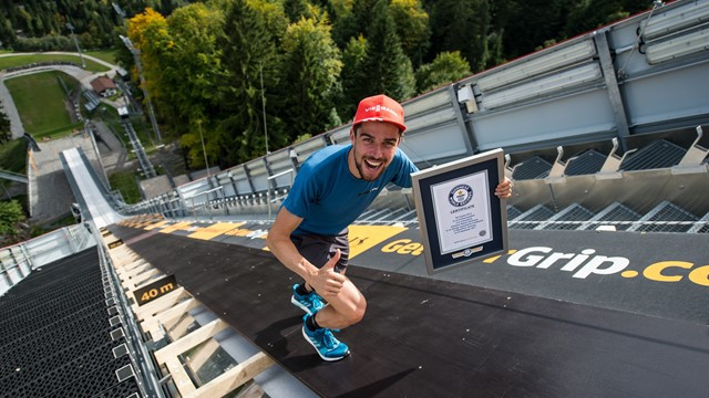 Rydzek enters record books after running up ski jump hill