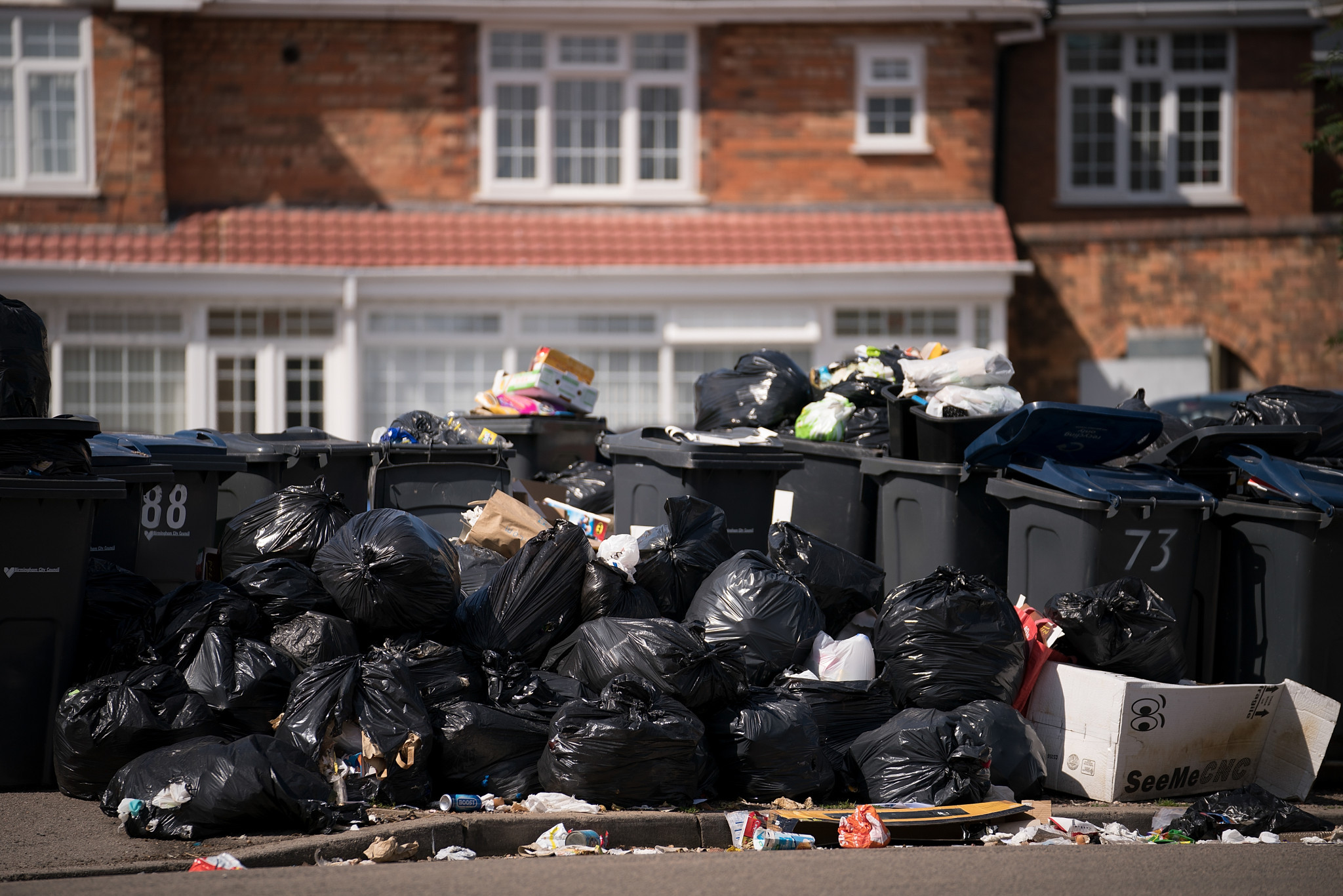 Rubbish has piled up in the streets of Birmingham because of a strike by refuse workers after the City Council cut services by £5 million as part of budget cuts ©Getty Images