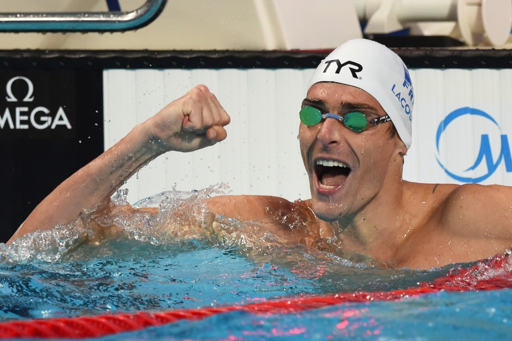 France's Camille Lacourt defended his men's 50m freestyle title