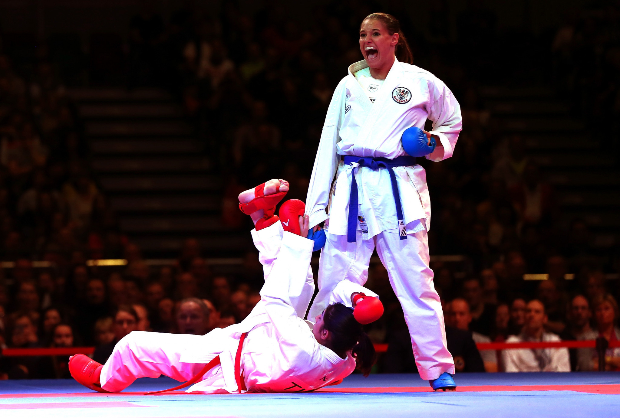 Alisa Buchinger, right, pictured competing at the 2014 World Championships. enjoyed a home victory today ©WKF
