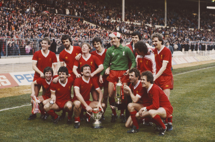 Liverpool celebrate after winning the first commercially-sponsored version of the Football League Cup in 1982 - the Milk Cup, which even had its own version of a trophy, held by Alan Kennedy in the front row, second right ©Getty Images