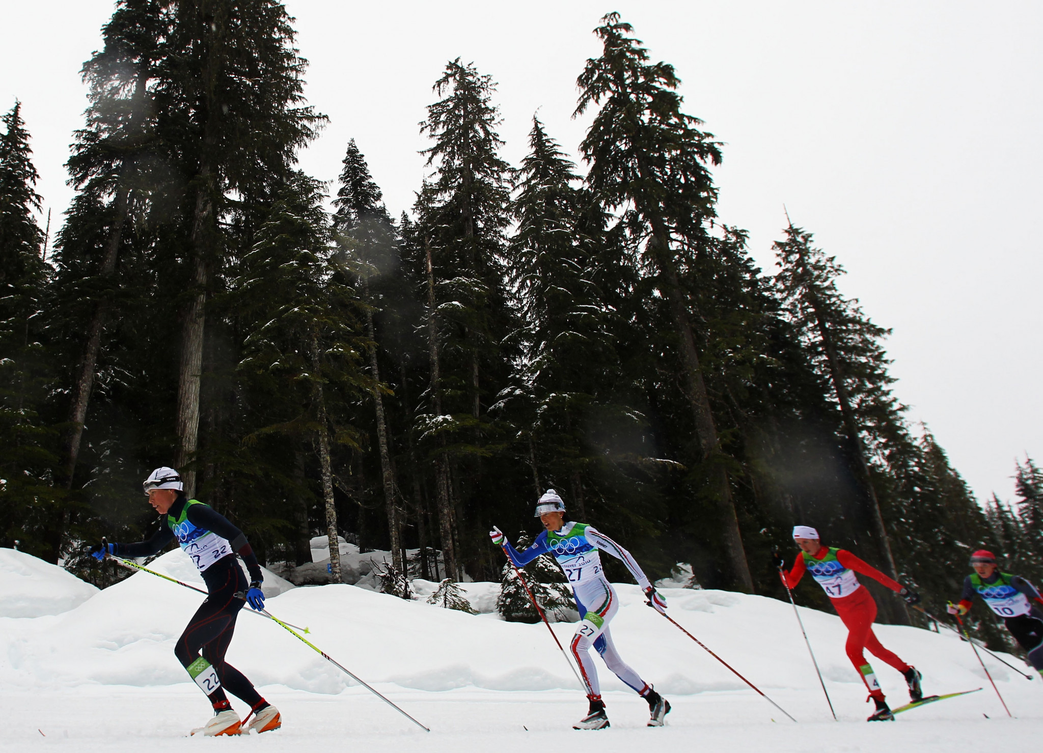 Polish cross-country skier Kornelia Marek, third left in red, is the only athlete to so far have been banned for doping at Vancouver 2010 but retests have revealed at least one other athlete tested positive ©Getty Images