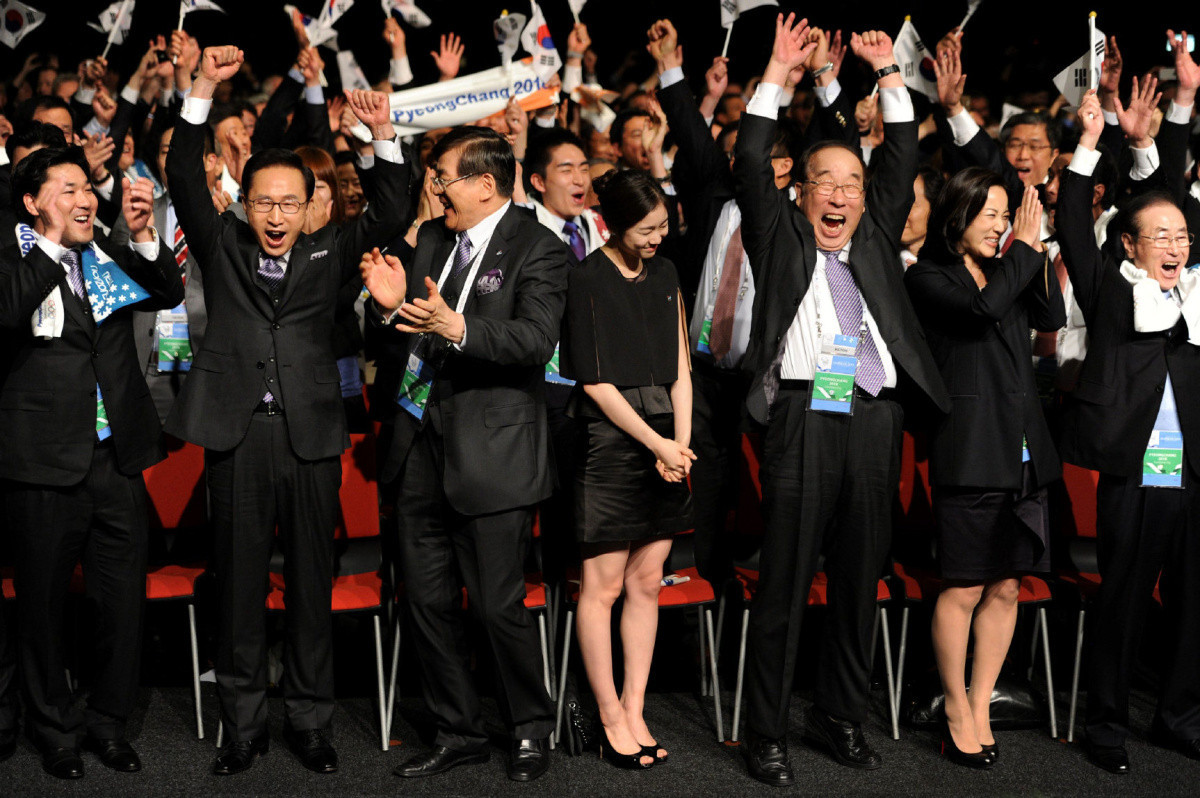 Cho Yang-ho, third left, celebrates after Pyeongchang were awarded the 2018 Winter Olympic and Paralympic Games at Durban in July 2011 ©Getty Images