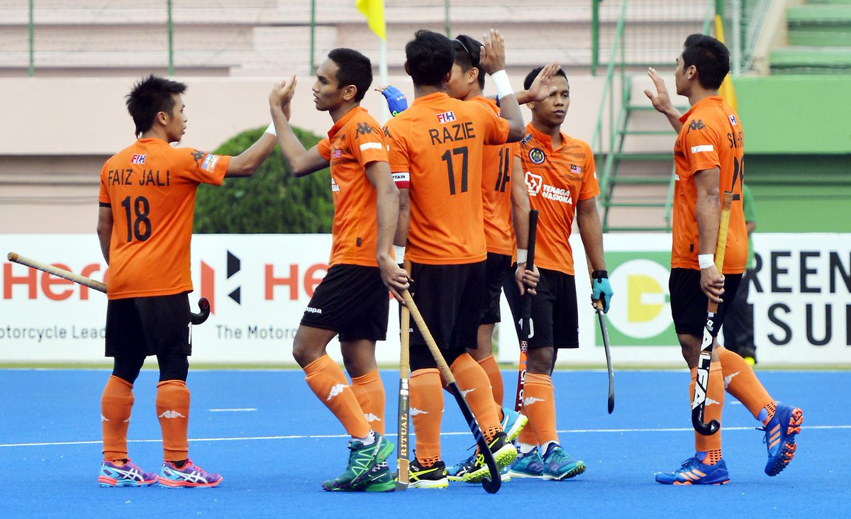 Malaysia secure top spot in group at Asia Cup