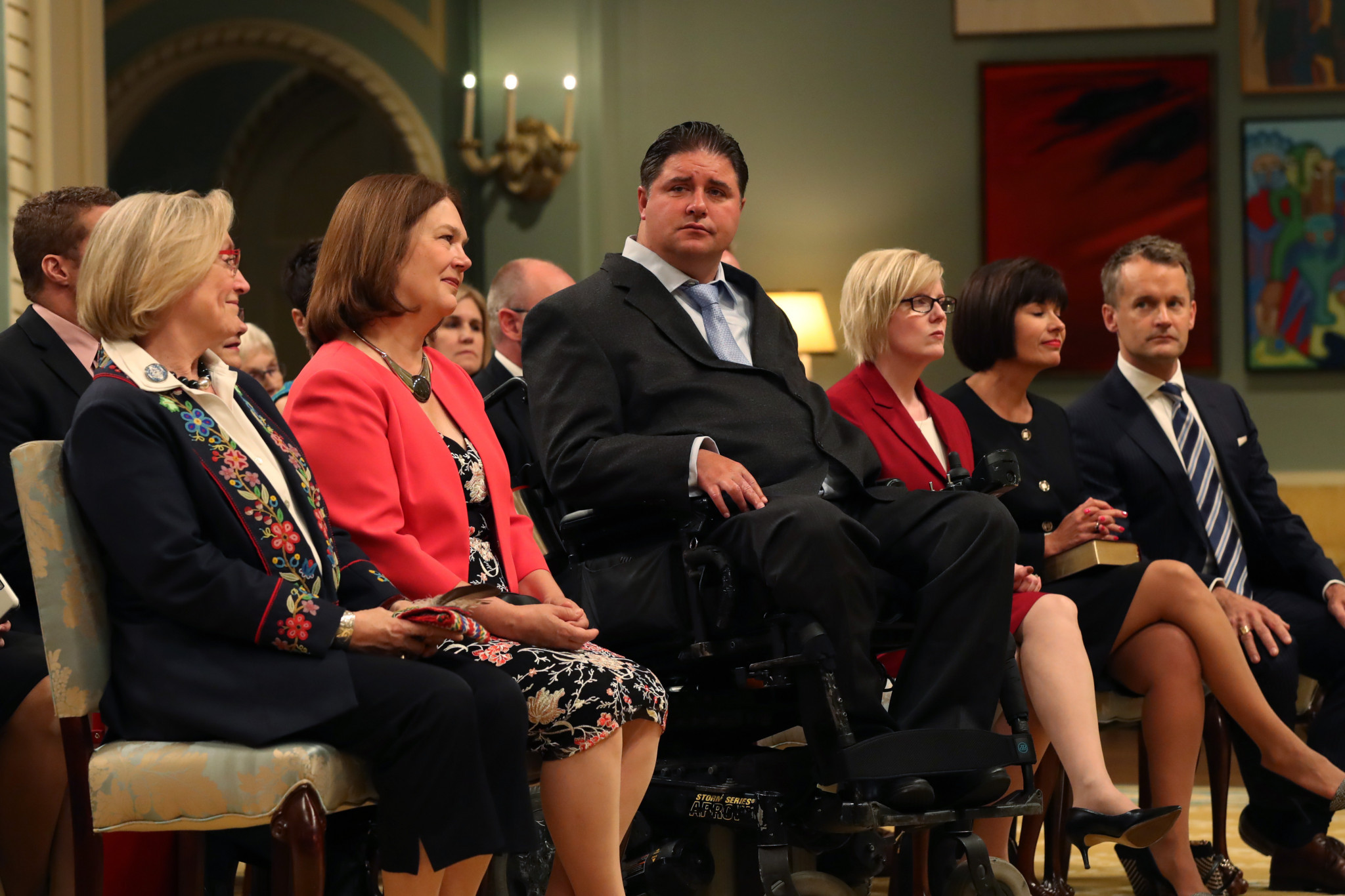 Kent Hehr, centre, is pictured with colleagues at a swearing-in ceremony for Canadian Government Ministers in Ottawa ©Getty Images
