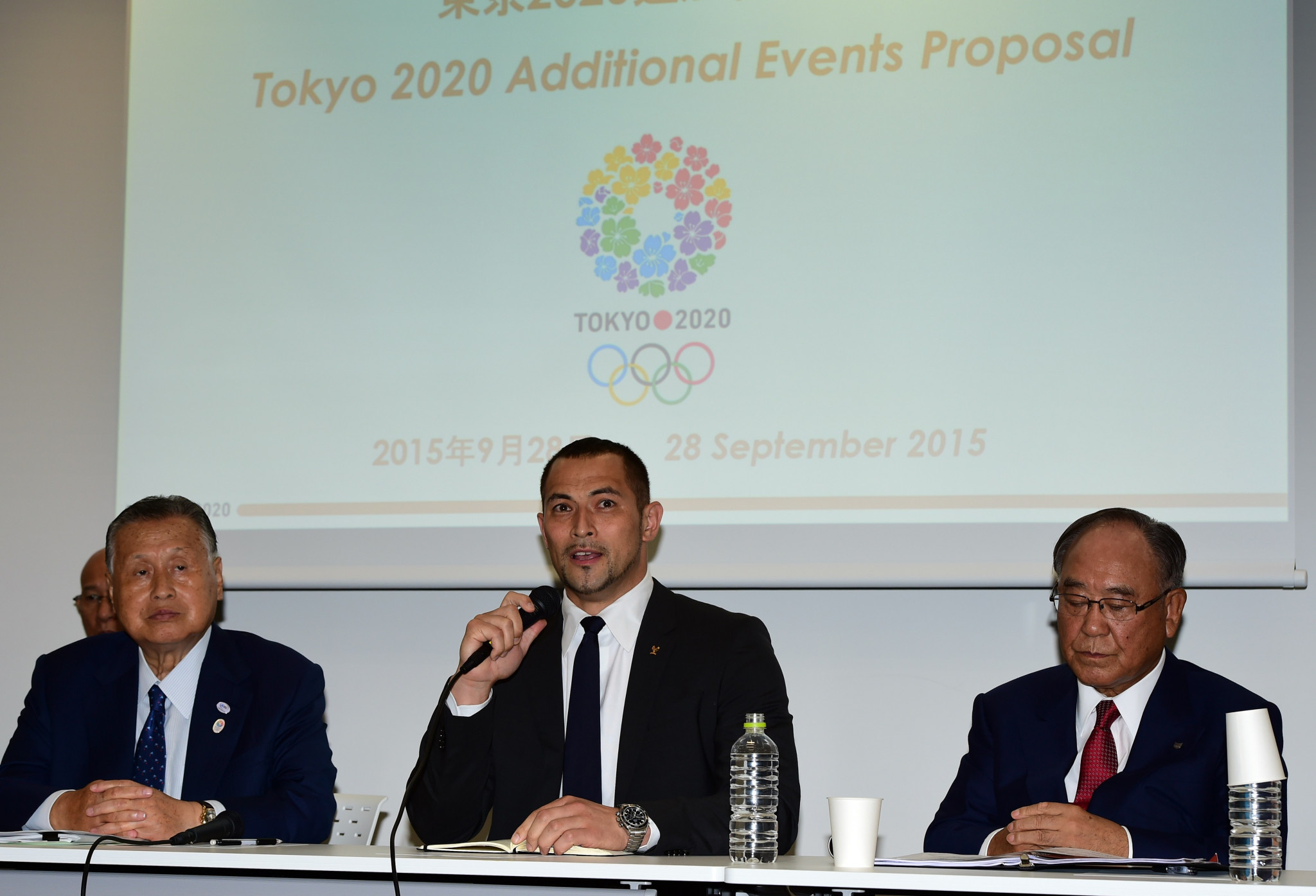 Tokyo 2020 sports director Koji Murofushi, centre, has put forward a different tournament system ©Getty Images
