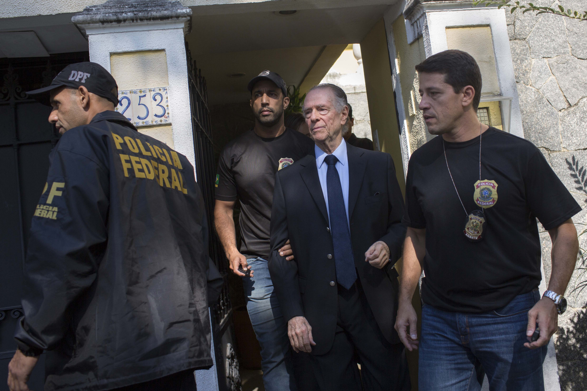 Rio 2016 President Carlos Nuzman, centre, is escorted from his home by Federal police after they had launched a probe into alleged buying of votes to secure the Olympic and Paralympic Games ©Getty Images