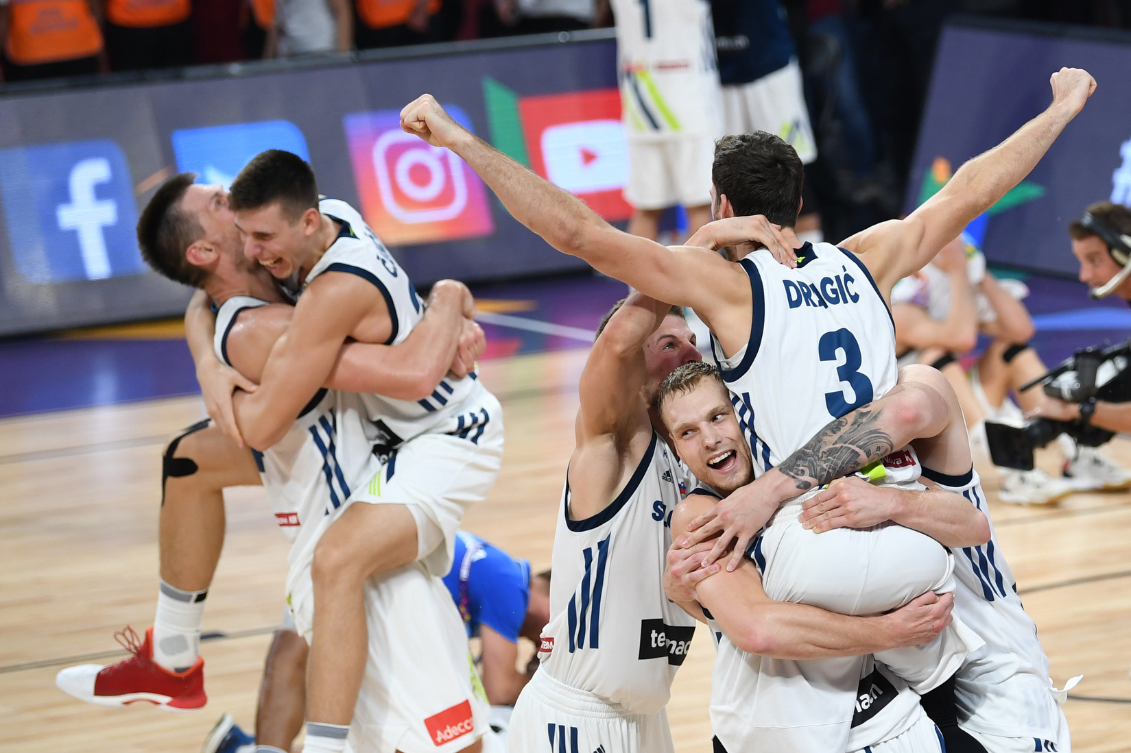 Slovenia's players celebrate after defeating Serbia during the FIBA Eurobasket 2017 men's final but now the world governing body claim the international game is under threat ©Getty Images