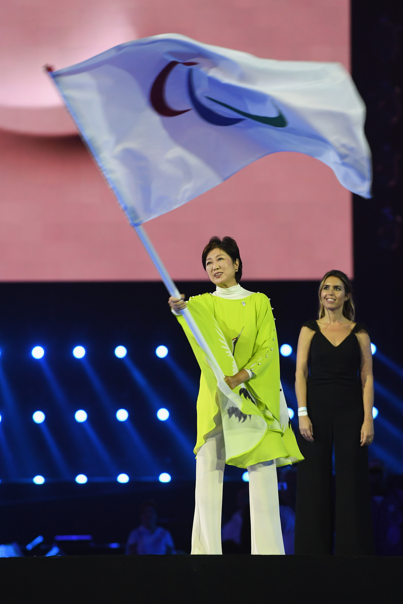 Tokyo's Governor Yuriko Koike waves the IPC flag during the Closing Ceremony of the Rio 2016 Paralympic Games ©Getty Images